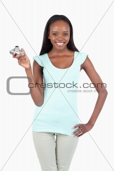 Young woman with digi cam and hand on her hip