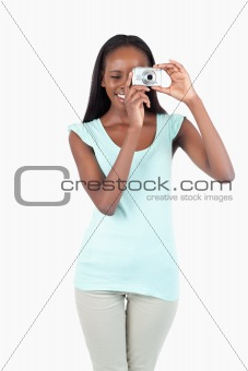 Smiling young woman taking pictures