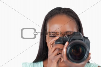 Close up of female photographer at work