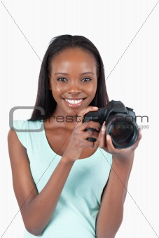 Smiling young photographer with her camera