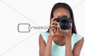 Young female photographer at work
