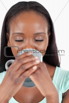 Close up of woman enjoying a cup of coffee