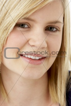 Studio Portrait Of Smiling Teenage Girl
