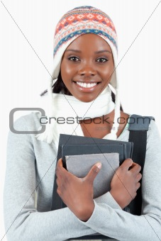Close up of woman with winter clothes and books