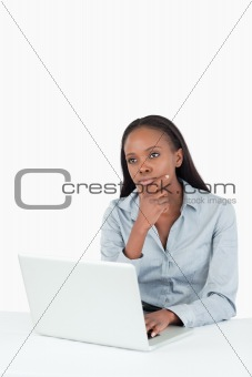 Thoughtful businesswoman using a laptop