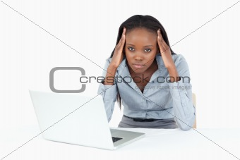 Tired businesswoman working with a notebook