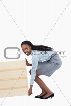 Portrait of a businesswoman dragging a panel