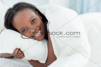 Close up of a young woman waking up