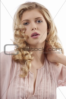blond young girl with curly hair posing towards camera