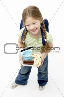 Studio Portrait of Smiling Girl Holding Lunchbox