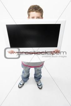 Portrait of Smiling Teenage Boy Holding Television