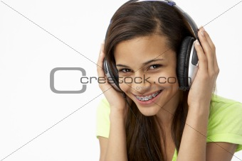 Portrait of Smiling Teenage Girl Listening to Music