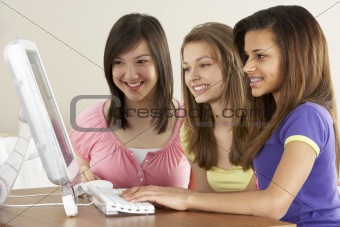 Teenage Girlfriends on Computer at Home