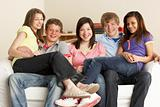 Teenage Friends Relaxing at Home