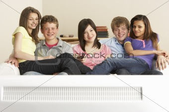 Teenage Friends Watching Television at Home