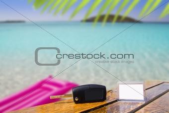 Car rental keys on wood table in vacation Caribbean
