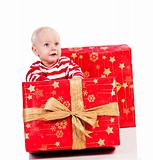 christmas baby boy with gift box, baby is sitting