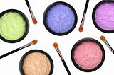 colorful cosmetics eyeshadows in box and brushes isolated on whi