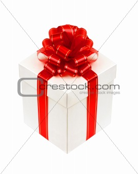 Beautiful white gift box with red ribbon bow isolated on white