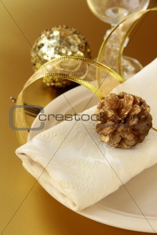 Beautiful and elegant gold place setting for christmas or celebrations