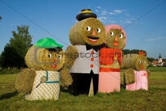 Four figures made out of straw bales