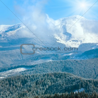 Morning cloudy winter mountain landscape.