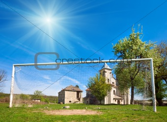Old church and football goal (Sydoriv village, Ternopil region,