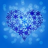 Christmas Snowflakes Heart Shape on Blurred Background