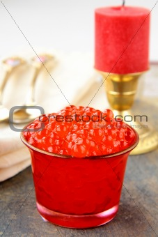 Fresh red caviar in a glass jar