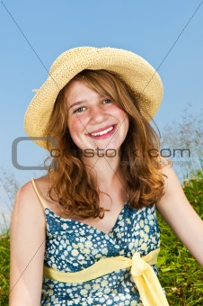 Portrait of young girl smiling in meadow