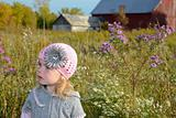 child in knitted pink cap