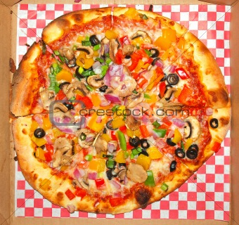 A Fresh and Healthy Vegetable Pizza on Red Checked Paper