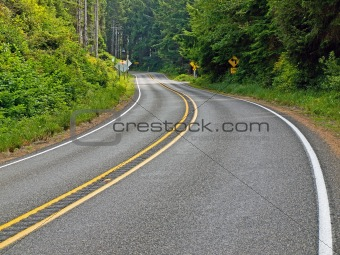 Curved Two Lane Country Road Winding Through a Forest