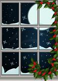 Winter window decorated with leaves and berries, snowfall and moonlight outside