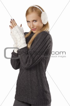 cute girl ready for the winter cold day standing  and feeling co
