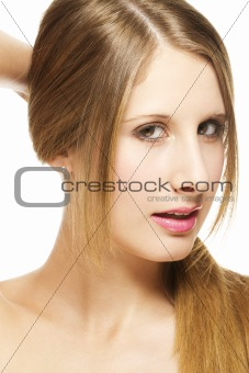 beautiful woman holding her hair to a pigtail