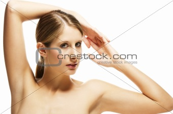 beautiful young blonde woman holding arms over her head