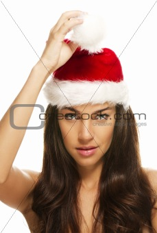 young beautiful woman holding tip of santas hat