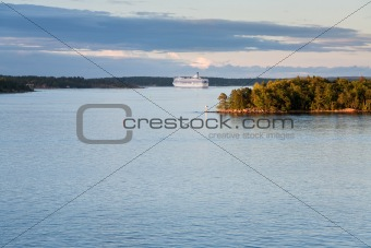 white cruise liner at sunset