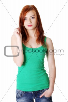Teen girl holding cigarette.
