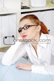 Beautiful woman thinking in the office.