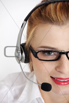 Closeup on woman`s face with headset.