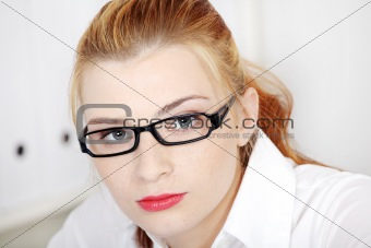 Businesswoman in glasses closeup.
