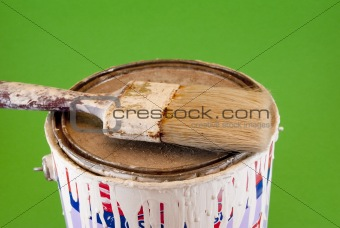 tin of painting and brush