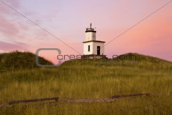 Lighthouse With Pink Dawn Sky