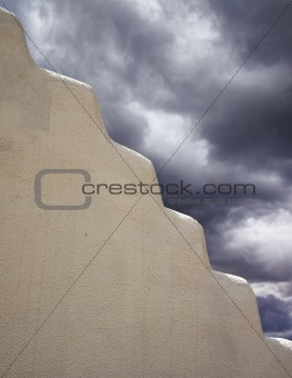 Adobe Wall With Storm Clouds