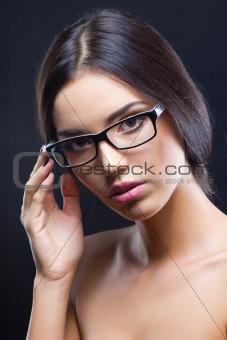 Attractive brunette girl wearing glasses
