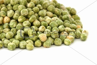 Close up view of scattered dried green pea on white background