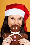 Santa Claus girl with gingerbread man puppet