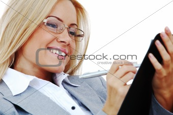 business woman hold a folder and write